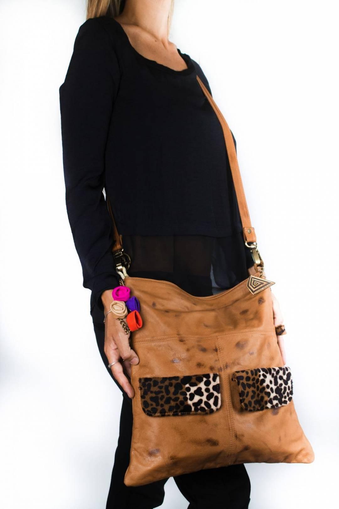 Cross body/handbag in leather and animal print pockets.